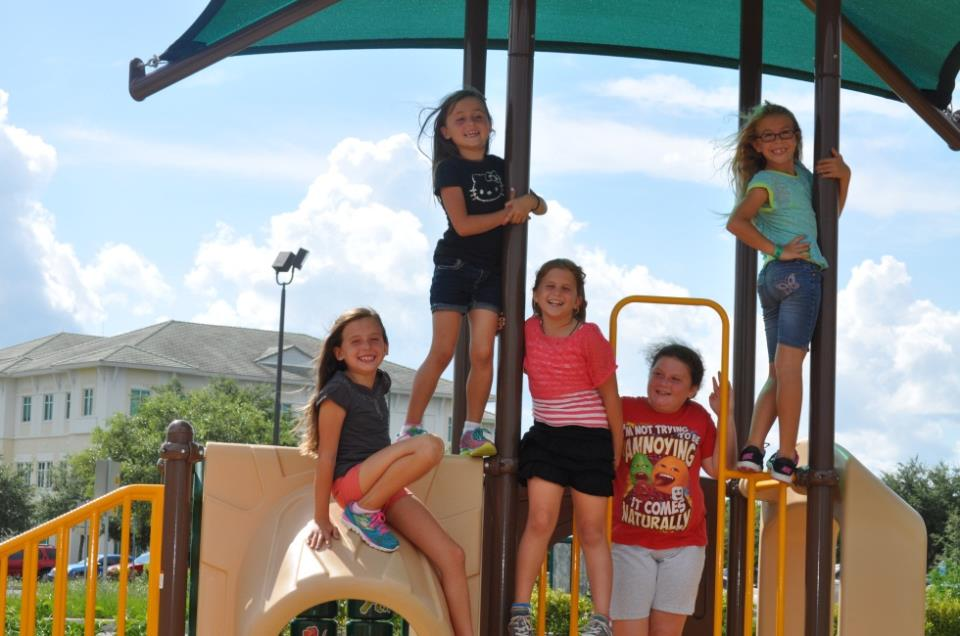 GMAC playground with kids posed