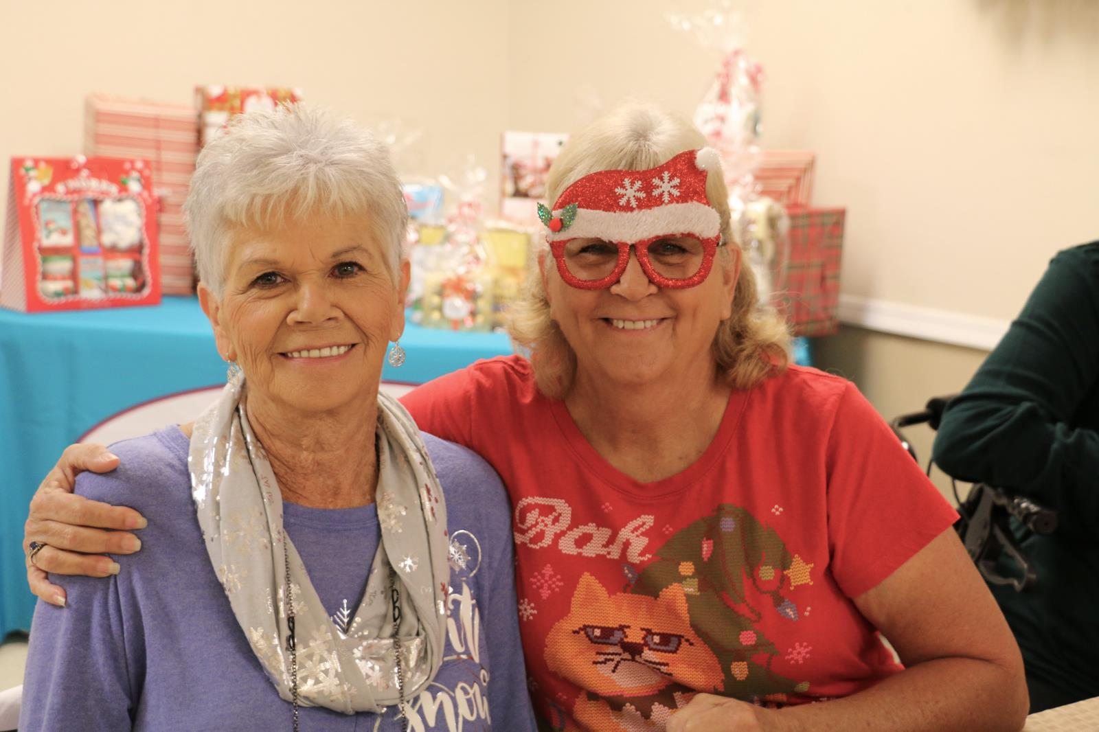two ladies at the senior giving tree