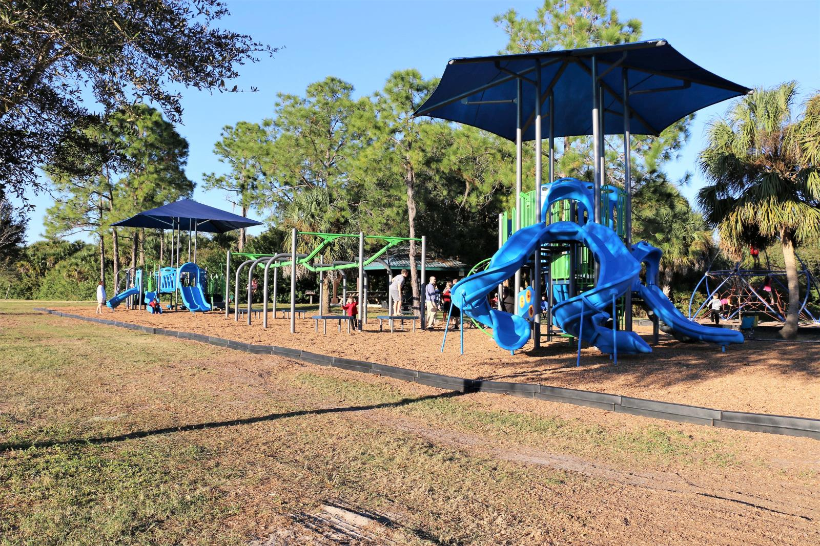 Playground with slides and canopy