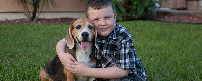 Boy hugs his dog in North Port, Fl.