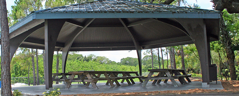 Pavilion with picnic tables and grill under shade