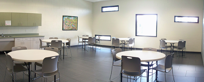 Large open meeting room with table and chairs