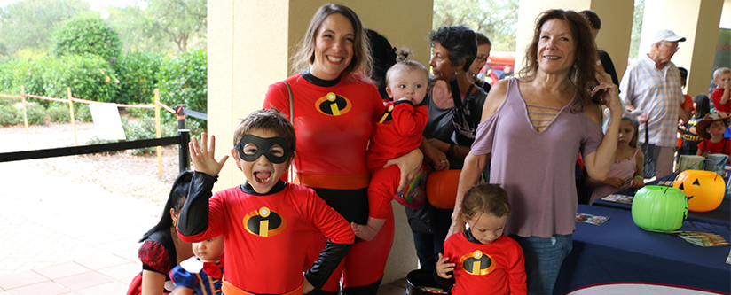 Family dressed in Incredibles costumes